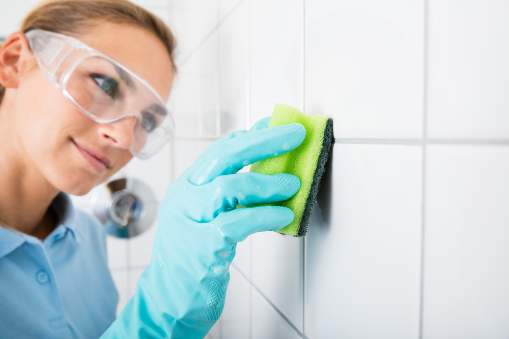 Woman Cleaning Grout in Shower, dri-masters, exterior home cleaning, carpet cleaning, tile and grout cleaning