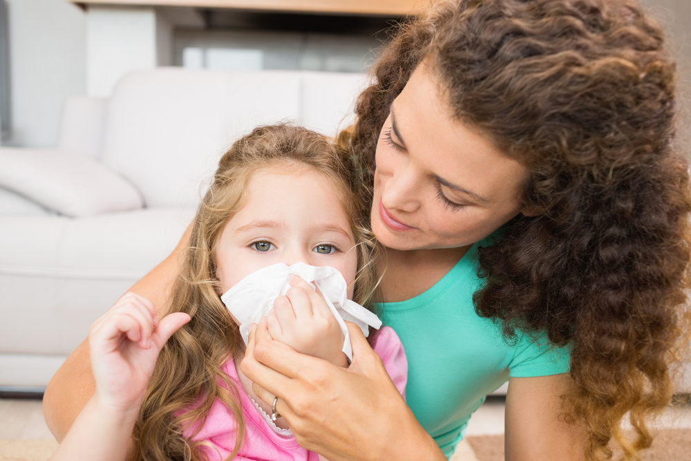 Mom and Daughter Sneezing from Allergens in Carpet